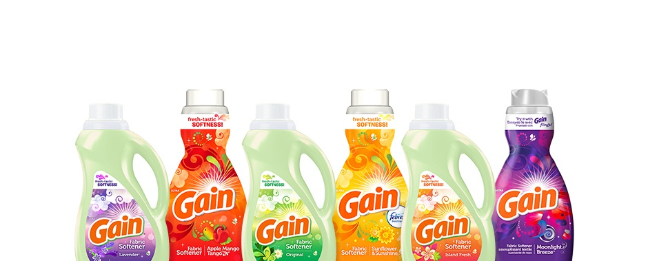 With the help of Gain fabric softener, we'll do the fluffing. You do the sniffing and folding.